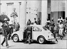 The deposition of Emperor Haile Selassie I (above rear window) from the Jubilee Palace on 12 September 1974, marking the coup d'état's action on that day and the assumption of power by the Derg.