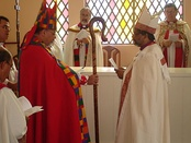 Bishop Maurício Andrade, primate of the Anglican Episcopal Church of Brazil, gives the crosier to Bishop Saulo Barros.