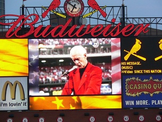 Video Replay on the scoreboard at Busch Stadium shown on the 5th anniversary of the 9/11 attacks of Buck reading his For America poem at Busch Memorial Stadium before the first Cardinals game after the 9/11 attacks.