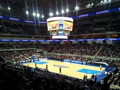 A Philippine Basketball Association game held at the Mall of Asia Arena.