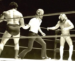 Savage (right) prepares to face off against Roberto Soto in a match held in Macon, Georgia on August 23, 1977[19]
