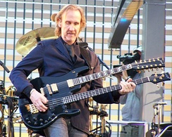 Mike Rutherford playing his distinctive double neck guitar, combining 12-string and bass.