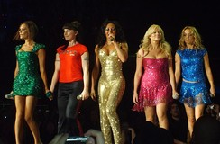 Brown (centre) performing with the Spice Girls.