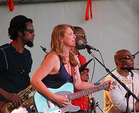 Susan Tedeschi and the Tedeschi Trucks Band at the Appel Farm Arts and Music Festival, June 2012. Kebbi Williams on saxophone, Maurice Brown on trumpet, and Saunders Sermons on trombone are in the background. (left to right)