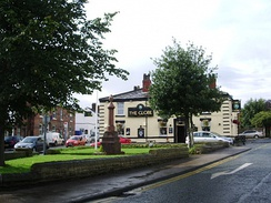 Standish Pillar War Memorial and The Globe pub