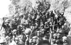 Men of U.S. 64th Regiment, 7th Infantry Division, celebrate the news of the Armistice, 11 November 1918.
