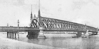 The Willemsbrug shortly after its opening in 1878, as seen from Noordereiland. A new bridge was completed nearby in 1981, and this one was demolished.