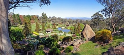 Panoramic view from the Symbolic Mountain at the Japanese gardens. The view takes in the gardens and the plains of the Cowra district across to the nearby mountains.