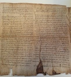 "While in Jericho, Origen bought an ancient manuscript of the Hebrew Bible which had been discovered ""in a jar"",[59] a discovery which prefigures the later discovery of the Dead Sea Scrolls in the twentieth century.[59] Shown here is a section of the Isaiah scroll from Qumran."