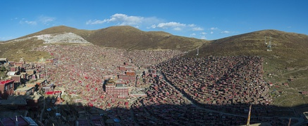 Larung Gar Academy of Tibetan Buddhism in Sêrtar, Garzê, Sichuan. Founded in the 1980s, it is now the largest monastic institution in the world, with about 40,000 members of which 1/10 are Han Chinese.