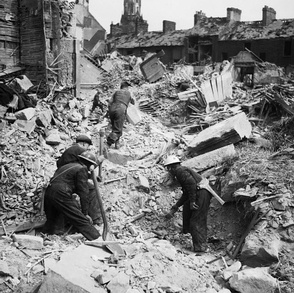 Rescue workers searching through rubble after an air raid on Belfast