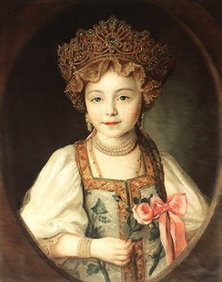 A Russian girl wearing kokoshnik and sarafan.
