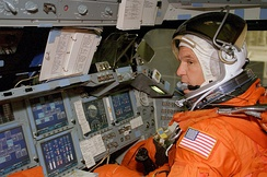 Picture of astronaut going through pilot training exercise.