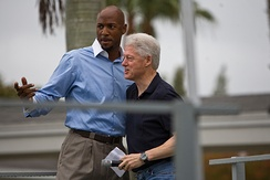Bill Clinton with Alonzo Mourning during CGI University Day of Service in Miami, Florida