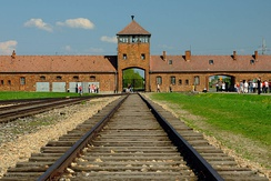 The infamous gatehouse at Auschwitz-Birkenau concentration camp, where at least 1.1 million people were murdered by the Nazi regime