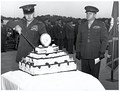 Franklin A. Hart cuts a cake for The Basic School while David M. Shoup looks on in 1951. Note that this cake has candles.