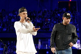 Bieber and manager Scooter Braun (right) during a show to promote Purpose in 2015.