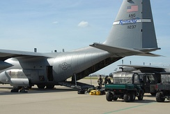 Members of the Kentucky Air Guard's 123rd Special Tactics Squadron load rescue gear onto a C-130 for deployment to coastal Texas .