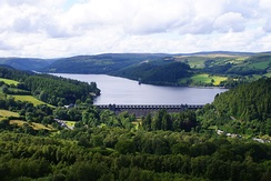 Lake Vyrnwy Reservoir. The dam spans the Vyrnwy Valley and was the first large stone dam built in the United Kingdom.