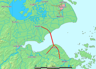 Hangzhou Bay extends from the East China Sea (right) to its namesake, the city of Hangzhou, where the Qiantang River flows in (lower left).  The red line shows the first bridge crossing of the bay, Hangzhou Bay Bridge. Zhoushan Islands is the archipelago, off Ningbo, at the southeast edge of the Bay (lower right).