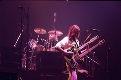 Genesis bandmate Mike Rutherford on bass with Collins on drums, performing in Toronto, 3 June 1977