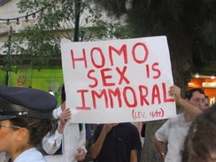 "Religious protestors at a pride parade in Jerusalem, Israel, with a sign that reads, ""Homo sex is immoral (Lev. 18/22)"". The association of homosexual sex with immorality or sinfulness is seen by many as a homophobic act."
