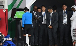 Referee César Arturo Ramos reviewing a play using Video assistant referee during a semi-final match between Qatar and UAE.