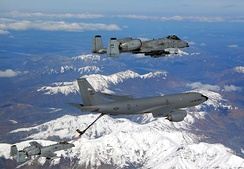 A KC-135 Stratotanker from the Alaska Air National Guard's 168th Air Refueling Wing flies in formation with two A-10 Thunderbolt IIs from the 355th Fighter Squadron over Alaska. The three aircraft assigned to Eielson Air Force Base, Alaska, flew in formation for the last time due to the inactivation of the 355th FS