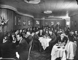 Margaret Sullavan and Leland Hayward among the patrons of the Stork Club in New York City (November 1944)