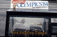 Newspaper vending machine announcing the 1984 Olympics.