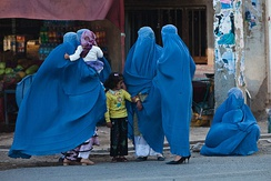 Local Afghan women wearing burqas on a street in 2009