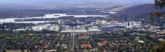 Canberra Civic viewed from Mount Ainslie with Lake Burley Griffin and Mount Stromlo in the background.
