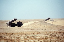 A Brazilian-made Avibras ASTROS-II SS-30 multiple rocket systems on Tectran 6x6 AV-LMU trucks stand in firing position while being displayed as part of a demonstration of Saudi Arabian equipment.