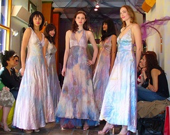 Models in silk dresses at the MoMo Falana fashion show