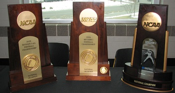 Appalachian State's National Championship trophies for 2005 (I-AA), 2006 (FCS), and 2007 (FCS).