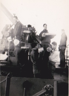 Seamen during shell loading practice aboard SS Lawton B. Evans in 1943