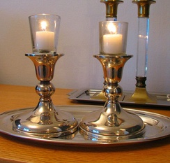 "Candles are lit on the eve of the Jewish Sabbath (""Shabbat"") and on Jewish holidays."