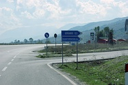 One road sign in Albanian and a minority language (Macedonian) and one in Albanian and a foreign language for tourists (English) in Pustec (left) Road sign in Albanian and a minority language (Greek) in Goranxi (right)