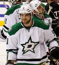 Tyler Seguin with the Stars in the 2013–14 season. The Stars acquired Seguin as a part of a seven-player trade with the Boston Bruins during the 2013 off-season.
