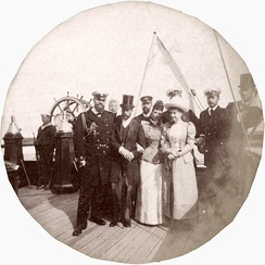 Left to Right: Emperor Alexander III, Prince George (later George V of the United Kingdom), Marie Feodorovna, Maria of Greece, Tsesarevich Nicholas (Later Emperor Nicholas II of Russia). Probably taken on the imperial yacht near Denmark, c. 1893.