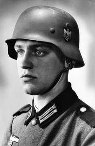 "The blond-haired, blue-eyed Werner Goldberg (1919–2004) was used in Wehrmacht recruitment posters as the ""ideal German soldier"". He was later ""dismissed"" after it became known that he was a ""Mischling ersten Grades"" as defined by the Nuremberg Laws, having half Jewish ancestry."