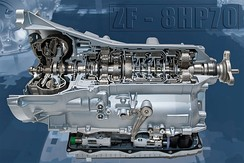 A cutaway of an 8-speed ZF 8HP showing the major stages of a hydraulic automatic transmission: the torque converter (left), the planetary gearsets and clutch plates (center), as well as hydraulic and electronic controls (bottom).