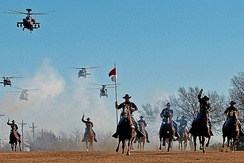 The 1st Cavalry Division's combat aviation brigade performs a mock charge with the horse detachment