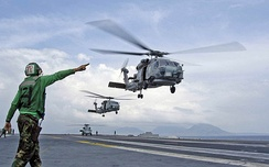 Helicopters depart from Abraham Lincoln en route to Aceh, Sumatra, supporting humanitarian airlifts to tsunami-stricken coastal regions in early 2005.