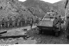 Yugoslav POWs supervised by Bulgarian soldiers and German armored car.