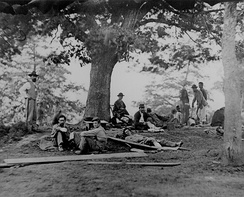 Wounded soldiers being tended at Marye's House in Fredericksburg in May 1864[note 2]