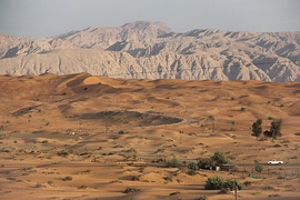 The northeastern Hajar Mountains, shared by Oman and the UAE, as seen from the desert of Sharjah