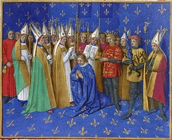 "Count Philip (2nd from right) as swordbearer at Philip II's coronation. The count of Flanders was one of the 12 ancient Peers or ""equals"" of the King of France. (1455 panel painting by Jean Fouquet)."