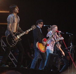 Original member Izzy Stradlin' on stage with Guns N' Roses in 2006.