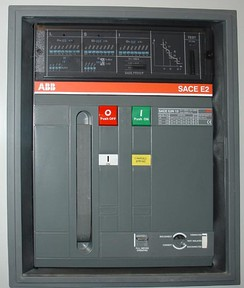 Front panel of a 1250 A air circuit breaker manufactured by ABB. This low-voltage power circuit breaker can be withdrawn from its housing for servicing. Trip characteristics are configurable via DIP switches on the front panel.